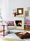 White living room with fireplace, swivel chair and scatter cushions