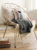 Cushions and blankets on metal chair