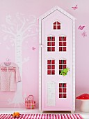 Child's bedroom in pink with mushroom lamp and house-shaped wardrobe