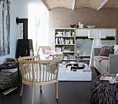 A living room with a brown leather floor, a sofa, a coffee table, a wall unit, a fireplace and an armchair