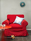 Red armchair with scatter cushion