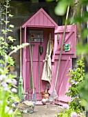 Gardening tools in shed painted pink