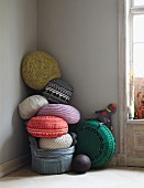 Various cushions stacked in a corner