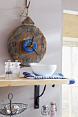 Kitchen clock hand-crafted from wooden board and caviar tin