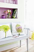 Photo print cushions on white wooden bench
