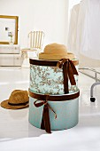 Round hat boxes decorated with velvet ribbons