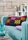 Colourful tweed scatter cushion on sofa in living room