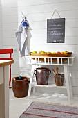Shelf of fresh apples in Scandinavian summer house