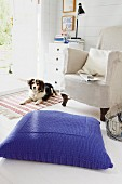 Large floor cushion with blue knitted cover