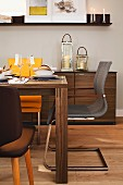 Dining room in shades of brown with sideboard, dining table & cantilever chairs