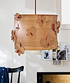 Pendant lampshade made from wood veneer decorated with wooden butterflies