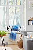 Decorative cushions on a window sill