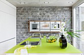 Kitchen with stone wall & green worksurface