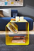 Yellow side table with magazine rack