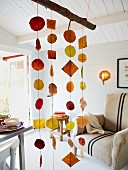 Interior decorated with autumnal mobile made from autumn leaves