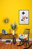 Yellow interior with retro-style table & rocking chair