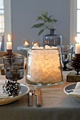 Rock sugar in an illuminated glass as Christmas table decoration