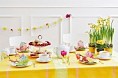 A festively laid table laid for Easter with cakes and tea