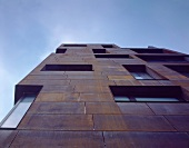 Apartment building with rusty Corten steel siding