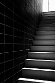 Staircase in front of a tiled wall