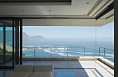Contemporary home with open patio doors and an impressive view of the ocean