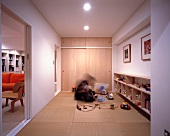 Man and child in a play room on tatami mats