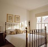Antique metal bed stead in a simple bedroom