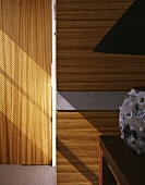 Wood paneling on a well next to a door