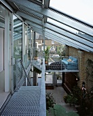 Covered courtyard with glass roof and with the stair access made of metal and gratings