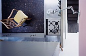 View of a kitchen gas oven and armchair in 50s style