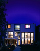 Illuminated contemporary house in the evening