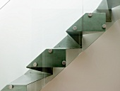 Side view of made-to-measure metal staircase with glass balustrade