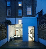 English town house with modern, renovated ground floor and view of illuminated living room