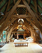 Renovated roof timbers with living room with impressive old wood construction