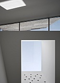 Brand new home with deep window niches and wedge-shaped skylight