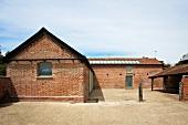 English grange with brick facade and barren courtyard