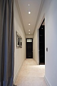 Narrow, minimalist hallway and wide passageway