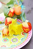 Easter bouquet with narcissus, tulips, Easter eggs as a table decoration