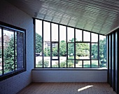 Empty room under a roof with a window and view of the garden