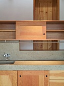 Custom made kitchen cupboards made of solid wood and work surface with integrated stone sink