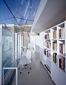 Library in front of a glass extension with contemporary architecture
