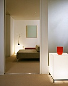 Cube shaped floor lighting next to an open door and view of a modern sofa