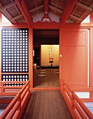 Traditional, Japanese home with bright red lacquered door and view of floor mats