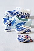 Dutch clogs and kissing couple made of porcelain