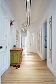 A hallway with a chest of drawers