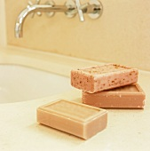 Bars of soap on a modern wash stand with wall taps