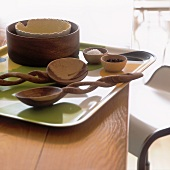 Wooden spoons and bowls on a tray