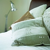 Decorative cushions on a bed