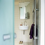 A view into a bathroom with a heated towel rail