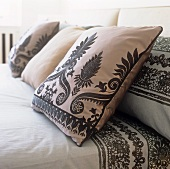Decorative cushions on a double bed